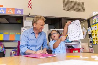 Hope Institute spokesman Pat Sajak, with a student at the group's Chicago school.