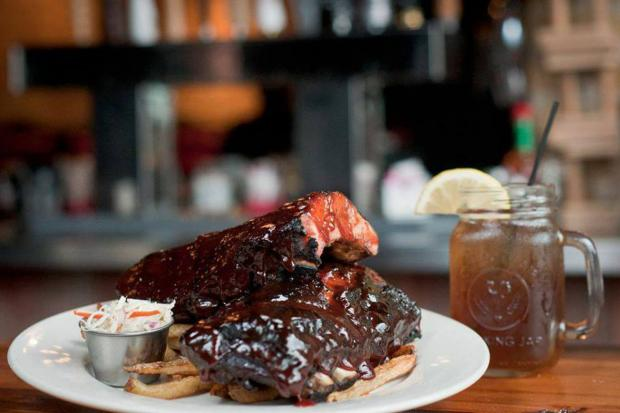 Porkchop brings a new menu with items like The Mouthful, a pulled pork sandwich, and The Fat Elvis, a bacon-studded Belgian waffle, to its new Hyde Park location.