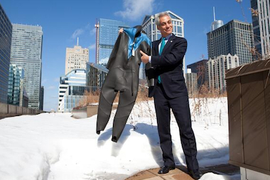 "Mayor Rahm Emanuel offers a wet suit to ""The Tonight Show"" host, Jimmy Fallon, to entice him to participate in the March 2 Polar Plunge."