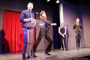 Second City writer Tim Mason explains the meaning of a dance as his colleague Kate James stretches while Hubbard Street dancers Meredith Dincolo and Quinn Wharton look on at Tuesday's announcement.