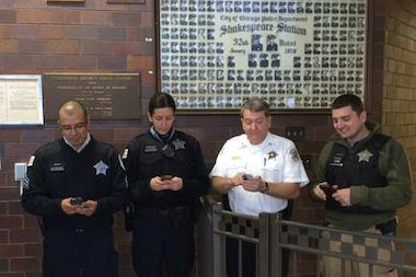 "On Jan. 17, the Shakespeare Police District tweeted a photo of the workers behind its tweets, announcing, ""Your 14th District Tweeters! Sgt. Reyes, Offr. Gonzalez, Capt. Buslik, Offr. Levine."""