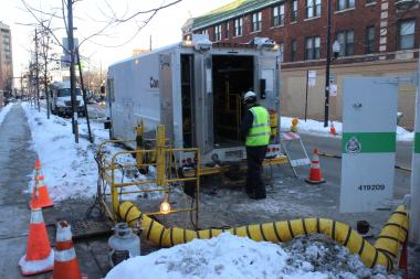 A pair of ComEd trucks were parked Monday at North Sheridan Road and West Cullom Avenue, where a worker could be seen working in a manhole.