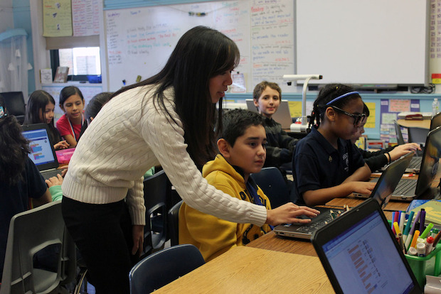 Sharon Vinh, a third-grade teacher at Brentano Elementary School in Logan Square, keeps students engaged with coding lessons and science experiments.