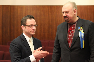 Ald. Joe Moreno talks with Pavo Bandrivsky of the Ukrainian Congress Committee of America after Tuesday's meeting.