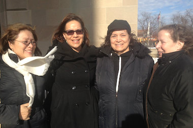 Maria Pike (from left), Myrna Roman, her mother Irma Roman, and Becky DeaKyne at the Cook County Courthouse.
