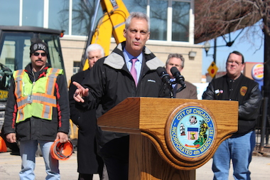 Mayor Rahm Emanuel said Wednesday he supports a city ban on plastic bags in stores but said he is working with aldermen to hammer out the details.