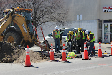 Crews fix a gas main Monday at Francisco and Devon avenues