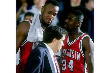Coach Stan Van Gundy talks with Howard Moore (right) and Rashard Griffith of the Wisconsin Badgers during a game against the Northwestern Wildcats at the Welsh-Ryan Arena in Evanston. Wisconsin won the game 70-56 on Feb. 15, 1995.