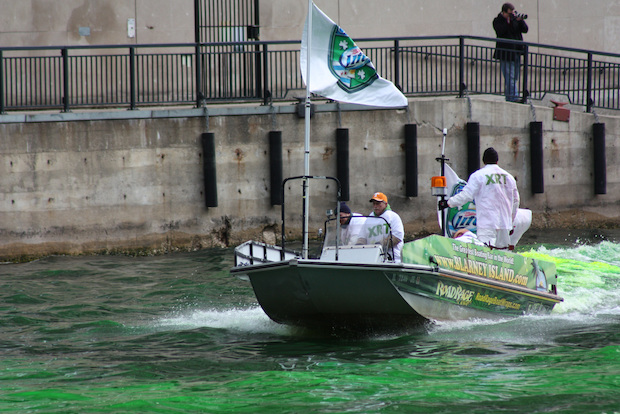 A boat dumped 50 pounds of vegetable-based powder to dye the Chicago River green before the 2015 parade.