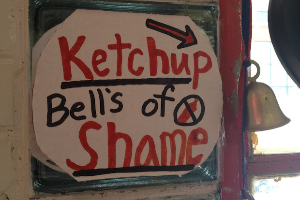 "At 35th Street Red Hots near U.S. Cellular Field, those who order ketchup on their hot dogs must ring the ""Ketchup Bells of Shame."""