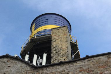 A view of the water tower from the alley behind the Swedish American Museum