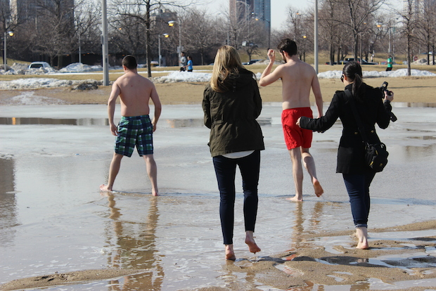 Chicago enjoyed the warm weather Monday but freezing temperatures and snow is expected Tuesday.