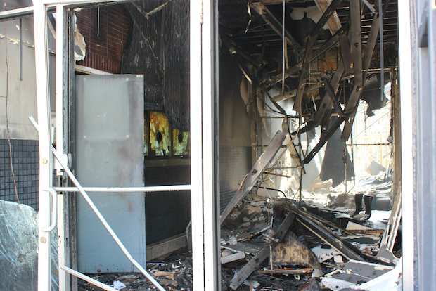 An early-morning fire gutted the Total Finance building and left neighbors without power.
