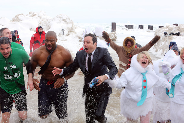 The mayor challenged the comedian to take a dip in the lake for charity Sunday.