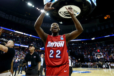 Kendall Pollard, a Simeon Career Academy graduate, of the Dayton Flyers celebrates after defeating the Stanford Cardinal 82-72 in a regional semifinal of the 2014 NCAA Men's Basketball Tournament at the FedExForum on March 27, 2014, in Memphis.