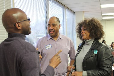 Daryl Powell and Savannah Williams talk to other drivers from the ride-sharing company Lyft after an event Monday night at the Chicago Urban League headquarters to recruit drivers.