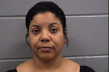 Mary Zavala, of Nashville, Tenn., nearly bit off another woman's lip at the Dolphin club in Bucktown, prosecutors said.