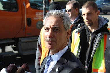 Mayor Rahm Emanuel touted the convenience of the parking meter app, but has not reached a compromise on Sunday parking in business districts.