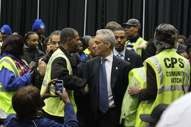 Mayor Rahm Emanuel shakes hands with a Safe Passage worker at Monday's celebratory luncheon at the UIC Forum.