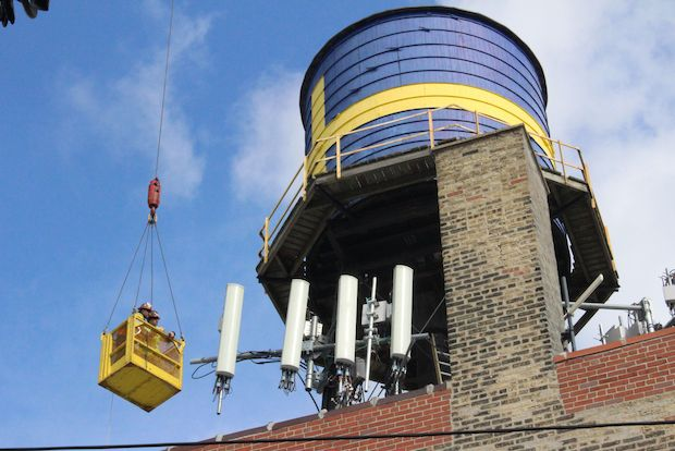 Andersonville's iconic water tower, painted to look like a Swedish flag,   will come down Thursday, to the dismay of residents who have come to regard the tower as a neighborhood staple.