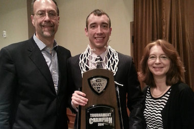 Western Michigan University junior guard Tim Brennan, a Lincoln Park High School graduate, and the Broncos will play Syracuse in the second round of the NCAA tournament Thursday in Buffalo. Here, Brennan poses with his parents, R.J. and Cheryl Lynn Brennan, after the Broncos' victory over Toledo in the Mid-American Conference Tournament championship game. The win clinched Western's first NCAA tournament bid since 2004.