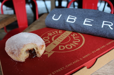 The UberX ride-sharing service is delivering paczkis Tuesday, but it insists that's not meant to bribe Chicagoans considering new regulations on the service.
