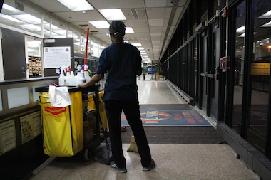 A custodian at Whitney Young Magnet Academy at work. According to Young principal Joyce Kenner, the school is set to host trainings for new Aramark custodial employees. Aramark was awarded a $260 million contract last month by the city's Board of Education.