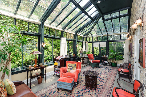 A five-bedroom 1920s Paris-inspired home with a conservatory is on the market for $4.9 million.