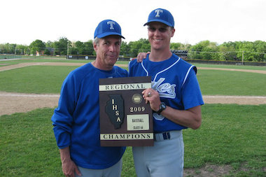 Rich Pildes (l.) poses with former assistant Matt Malarski after Taft High School won an IHSA baseball regional title in 2009. It's the only IHSA regional title in any sport in the school's history.