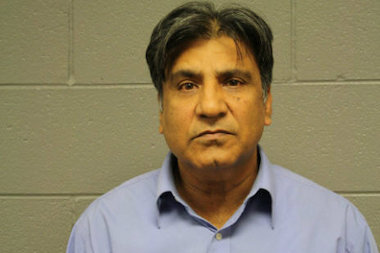 Anwar Khan, 56, of Skokie, is charged with failure to report an accident involving injury after prosecutors said he hit a man in West Rogers Park while trying to parallel park.