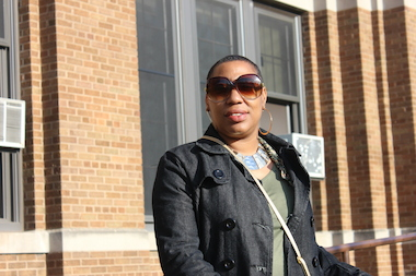 Asiaha Butler, president of the Resident Association of Greater Englewood, stands in front of Elihu Yale Elementary School, which was one of six elementary schools in Englewood closed in 2013.
