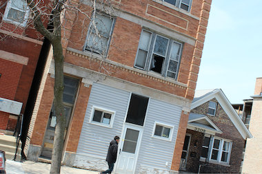 A pedestrian walks by a vacant building in the 3300 block of South Lituanica Avenue in Bridgeport.