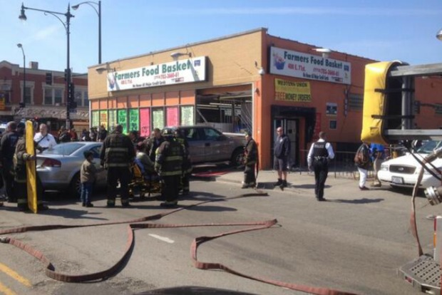 A truck struck a 61-year-old woman and building on the South Side Friday afternoon.
