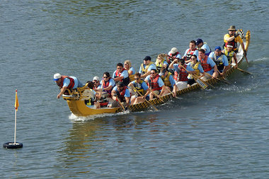 Competitors at the Dragon Boat Race for Literacy in Chinatown race to capture a flag in the Chicago River.