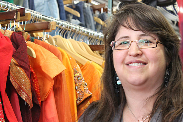 Thrift store partners with schools and charities on a voucher program for free merchandise.