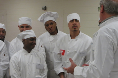 Inmates listen to chef Bruno Abate, who has a zero-tolerance policy in the culinary program he runs at Cook County Jail.