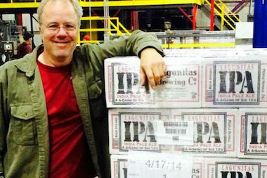 Lagunitas Brewery founder Tony Magee stands next to the first batch of Chicago-brewed IPAs. Maria's Community Bar in Bridgeport is hosting a bash for the brewery's Chicago arrival.