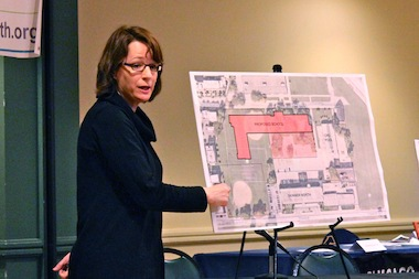 Meghan Harte, the mayor's deputy chief of staff, explains the boundaries of Obama College Prep during a meeting Monday night.