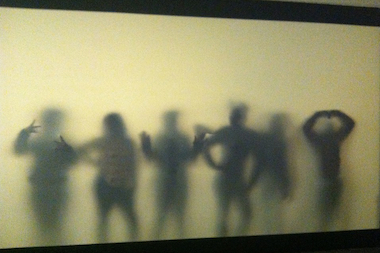 The participants in the New Lens Project pose for a silhouette photo.