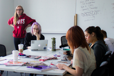 Bronte Price, left in red, instructs a group of students during a session of the New Lens Project.