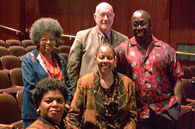Regina Baiocchi (center) with the judges at last year's Haiku Fest award ceremony at the Harold Washington Library Auditorium.