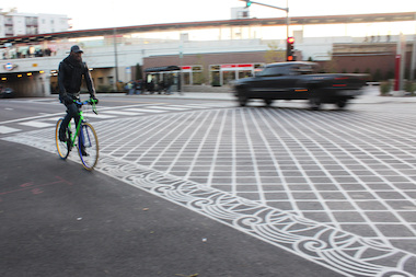 "A man rides on Sheridan Road, a north-south route that one Far North Side cyclist called ""very dangerous"" for bicycles."