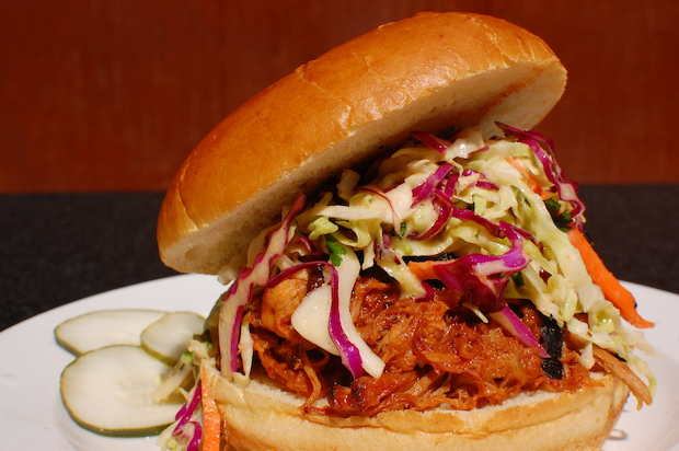 Pulled pork sandwiches like this one will be served up during The Smoke Daddy's pig roast on May 17.