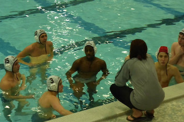 Mount Carmel water polo head coach Tina Grunauer instructs her players earlier this season.