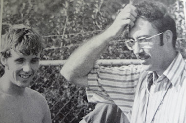 Brother Richard Grenier (r.) watches a Marist High School track and field meet during the 1970s. Grenier, who has been at the school since 1969, has coached several of the school's teams.<br />
