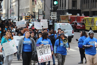 Students march from CPS headquarters to the Thompson Center protesting school disciplinary policies.