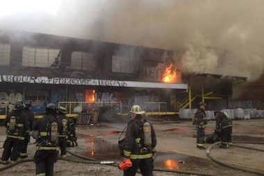 The abandoned warehouse caught fire Monday evening, fire officials said.