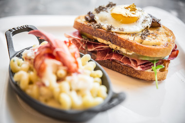 "Deca Restaurant + Bar's ""Zillion Dollar Grilled Cheese,"" priced at $100 and featuring gold-infused cheddar, celebrates National Grilled Cheese Month."
