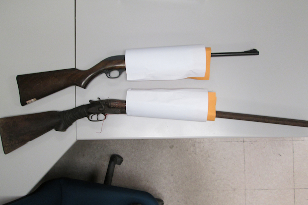Police said a tip from a concerned citizen helped them recover a rifle, shotgun, rifle scope and ammunition.