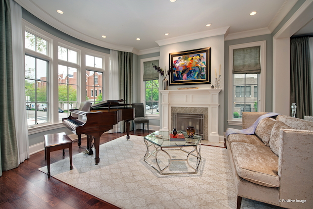 """This highly detailed and upgraded home has every possible luxury,"" according to the listing by Emily Sachs Wong of @properties.  In addition to having 5,449 square feet of interior space, the home features heated sidewalks, a floor-to-ceiling stone fireplace, two mud rooms and bathrooms attached to each bedroom."
